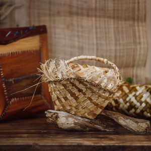 woven basket with handle and decorative fringe