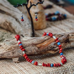 necklace and earrings with red seed tree beads and blue beads