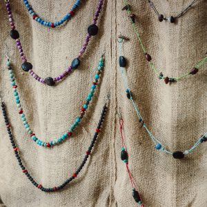 neckalces by Amber Vicum using native seeds along with beads and cord to create beautiful necklaces and jewellery